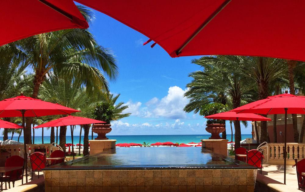 Red umbrellas and infinity pool at Acqualina Resort & Spa