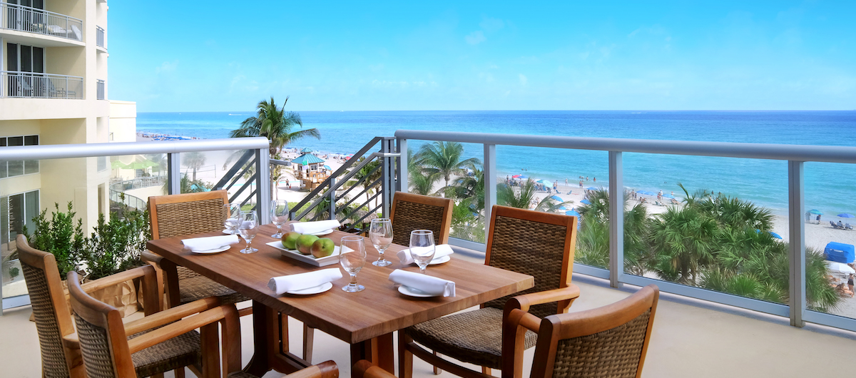 Sole on the ocean table set up for lunch on the balcony overlooking the ocean.