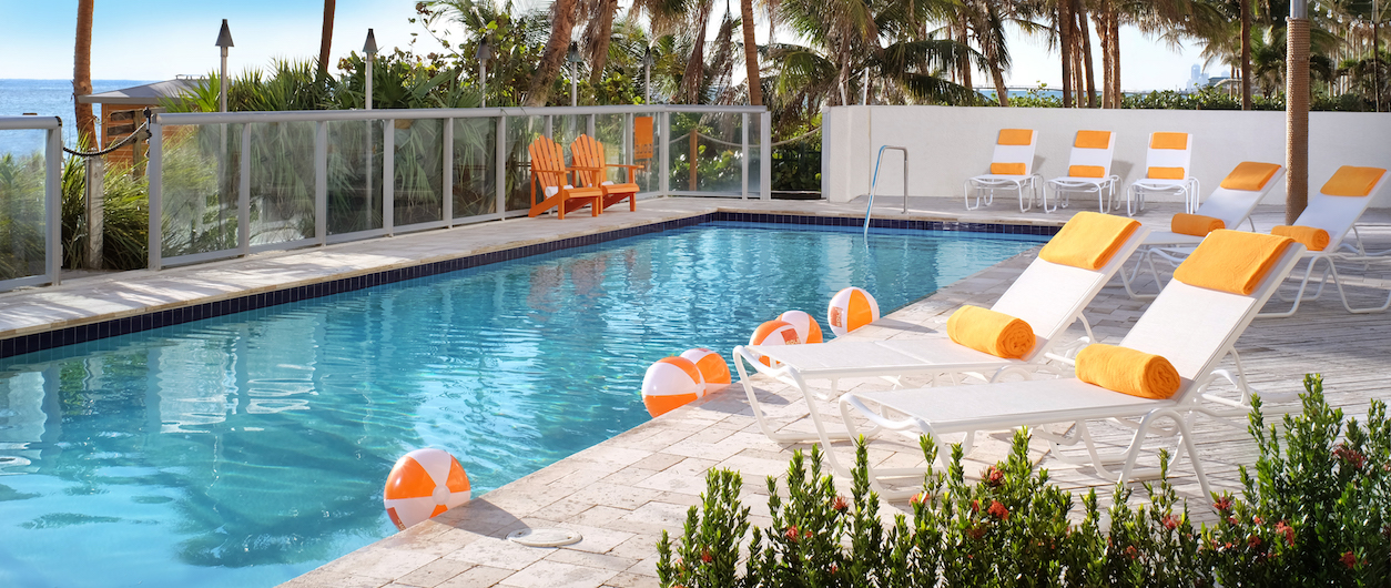 Sole on the Ocean pool with orange and white beach balls scattered around.