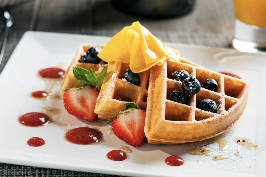 waffle with fruit on a plate.