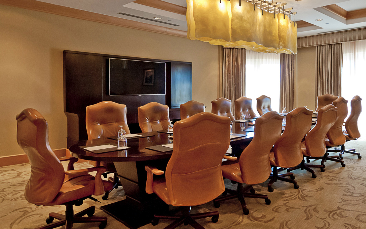 Boardroom meeting room with long table and chairs.