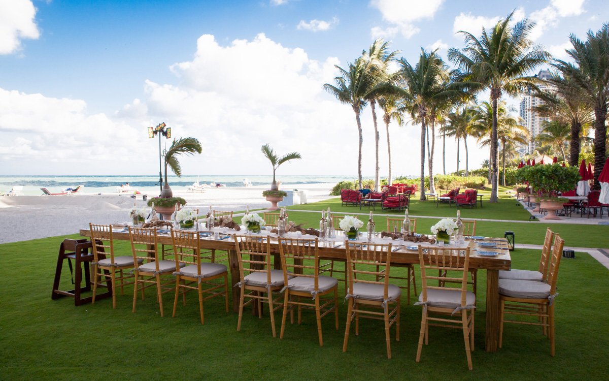 Table set up on the front lawn with catering.