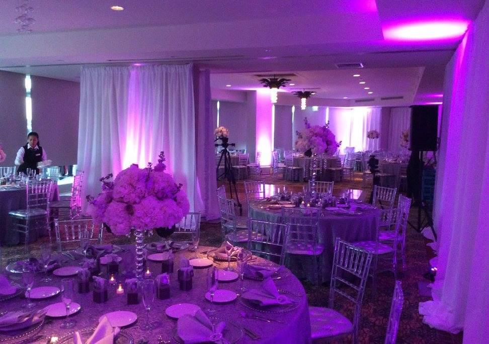 Room at the Doubletree Hotel with tables and place settings for a reception.