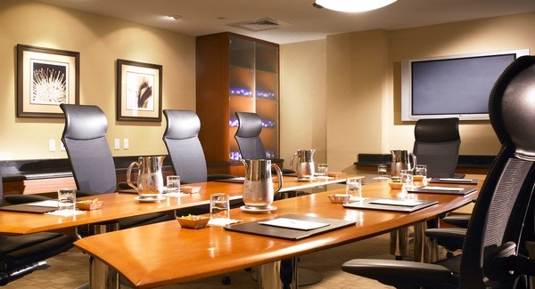 Boardroom table with settings.