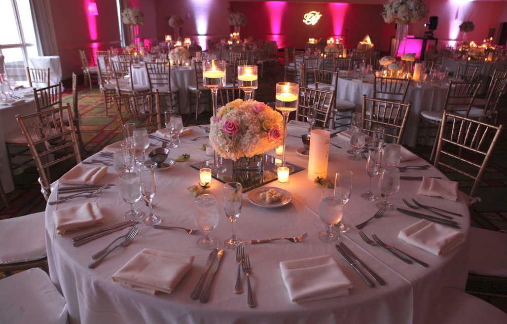 Table setting with a flower setting in the middle.