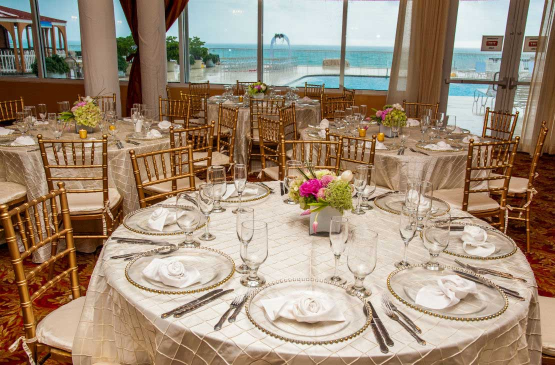Set table in a reception area overlooking the atlantic ocean.