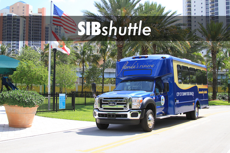 SIBshuttle bus making a stop in a residential area.