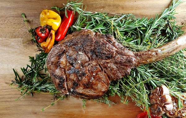 T-bone Steak with grilled veggies on a bed of fennel