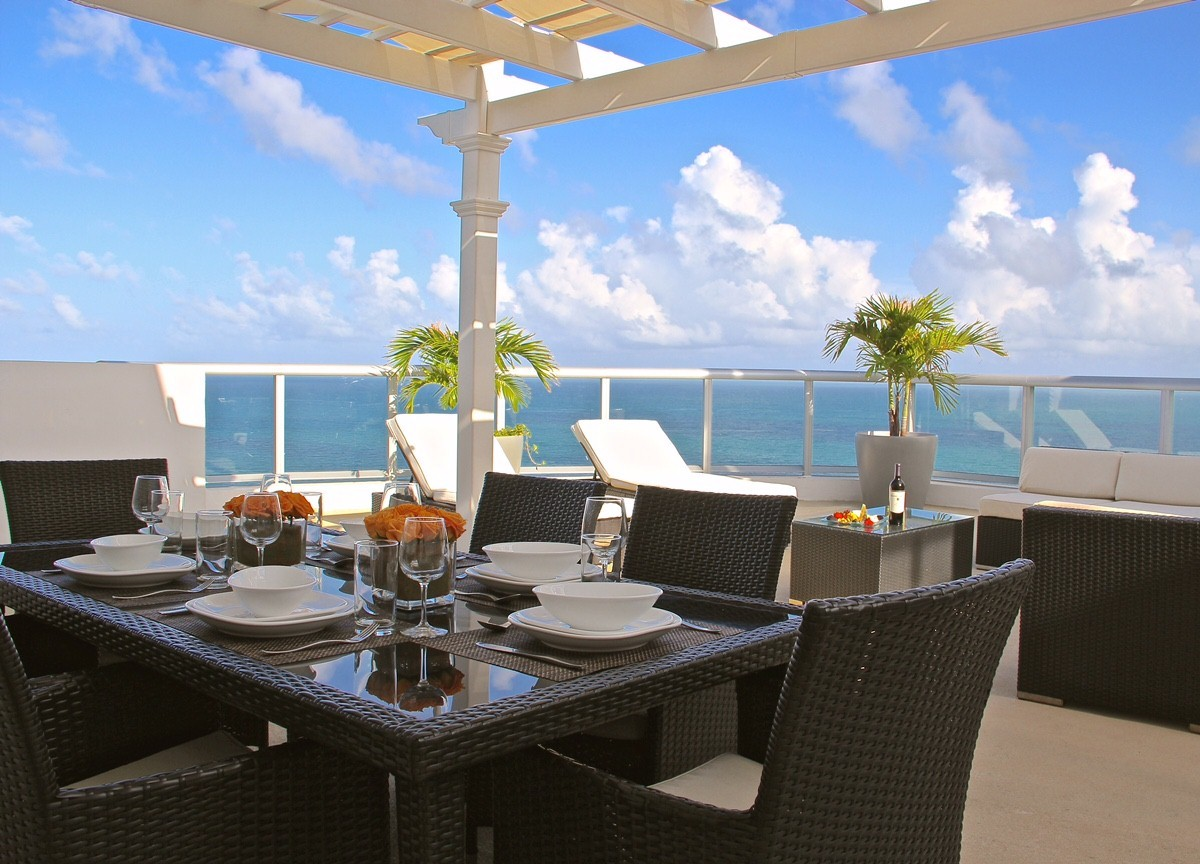Ocean penthouse at Marenas beach resort. Dining table set up on the balcony.