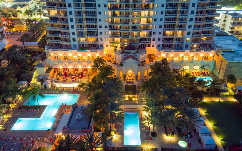 View of pools at night at Acqualina Resort & Spa