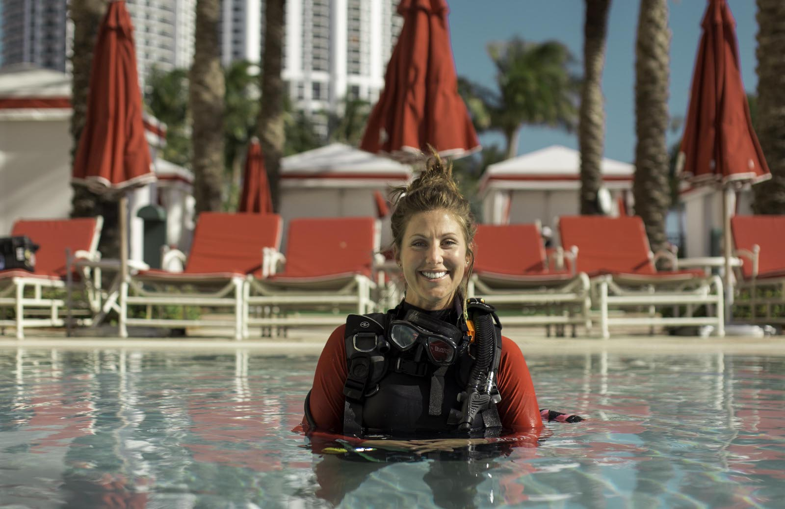 Woman in pool at Acqualina with scuba suit on.
