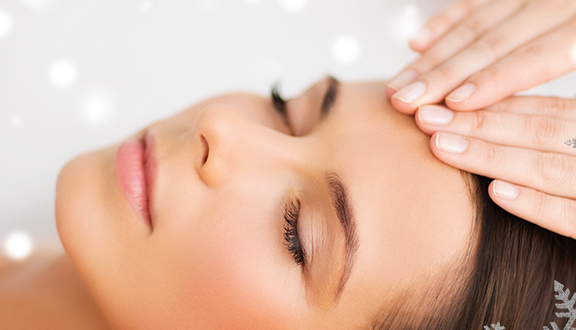 Woman receiving spa facial