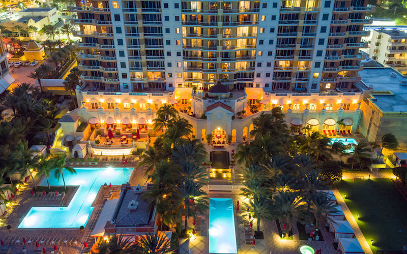 Acqualina Resort & Spa pool and hotel nighttime view
