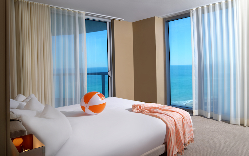 Room with orange and white beachball resting on the bed at Solé on the Ocean