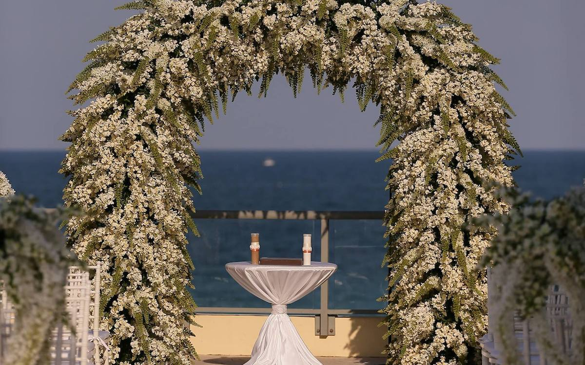 Decorated wedding arch at Doubletree Ocean Pointe