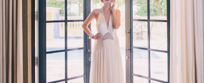 Bride standing in front of window at Acqualina