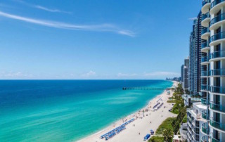 View of the Sunny Isles Beach coast with turquoise ocean waters and white sand beaches