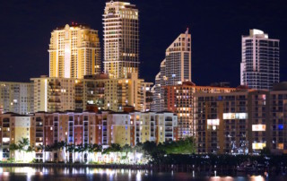 View of the city buildings and lights of Sunny Isles Beach over the Intracoastal Waterway