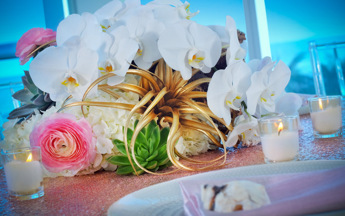 Flower bouquet on table by candles