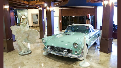 Classic car and 60's statue inside lobby at Days Hotel Thunderbird