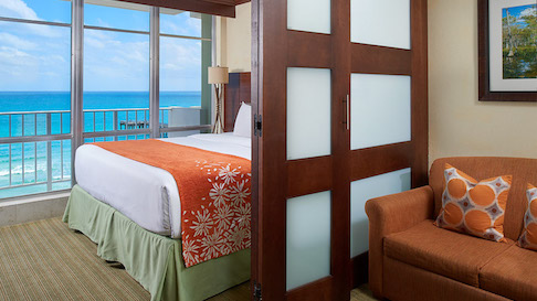 Room at the Newport Beachside Hotel and Resort with view of the ocean and pier.