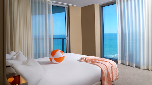 Solé on the Ocean interior with beachball on bed