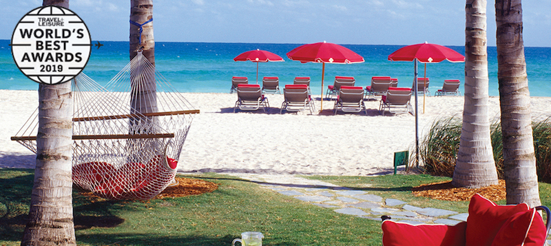 Hammock and beach chairs on the sandy beach at Acqualina Resort and Spa
