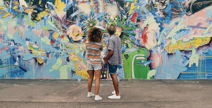 Couple looking at graffiti art in Miami.