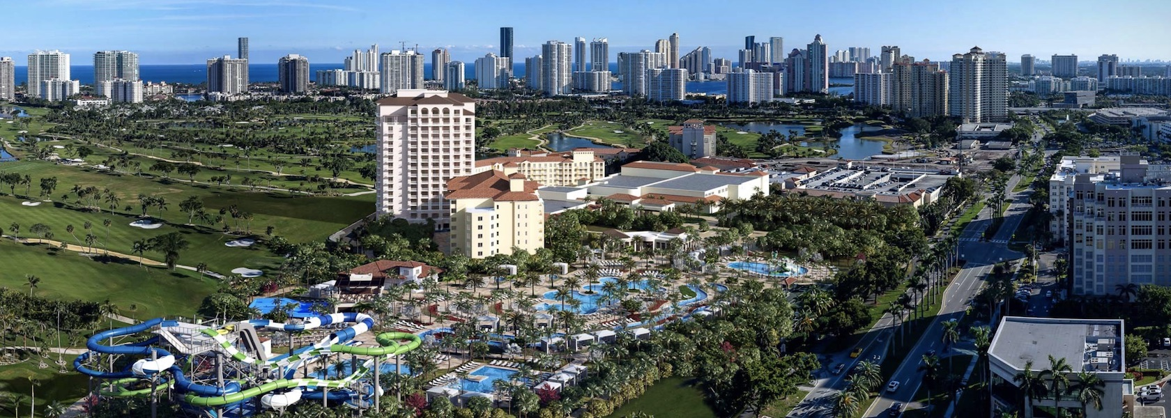 Aerial overview with city skyline in the background of the JW Marriott Turnberry Isle Miami