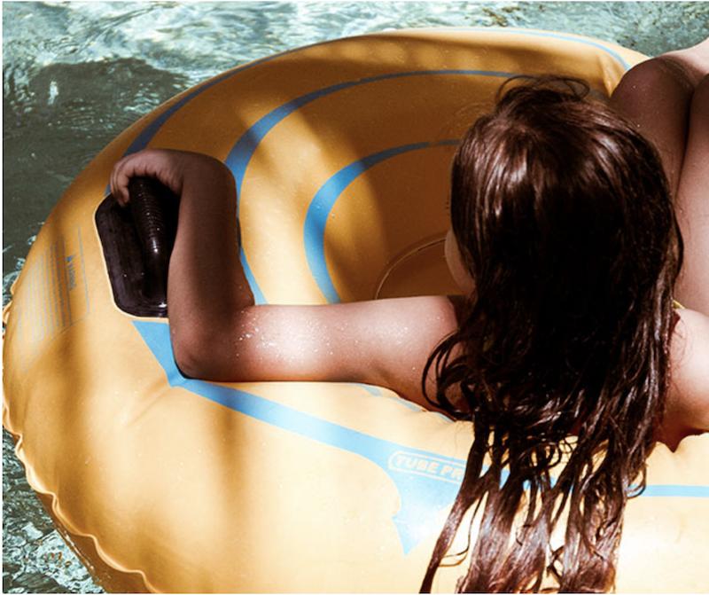 Girl in water in intertube