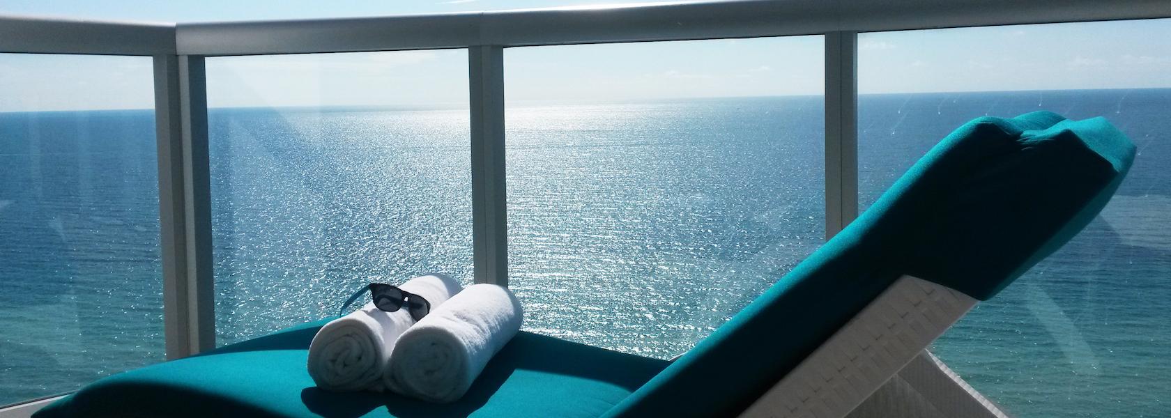 Lounge chair on balcony overlooking ocean at Marenas Beach Resort