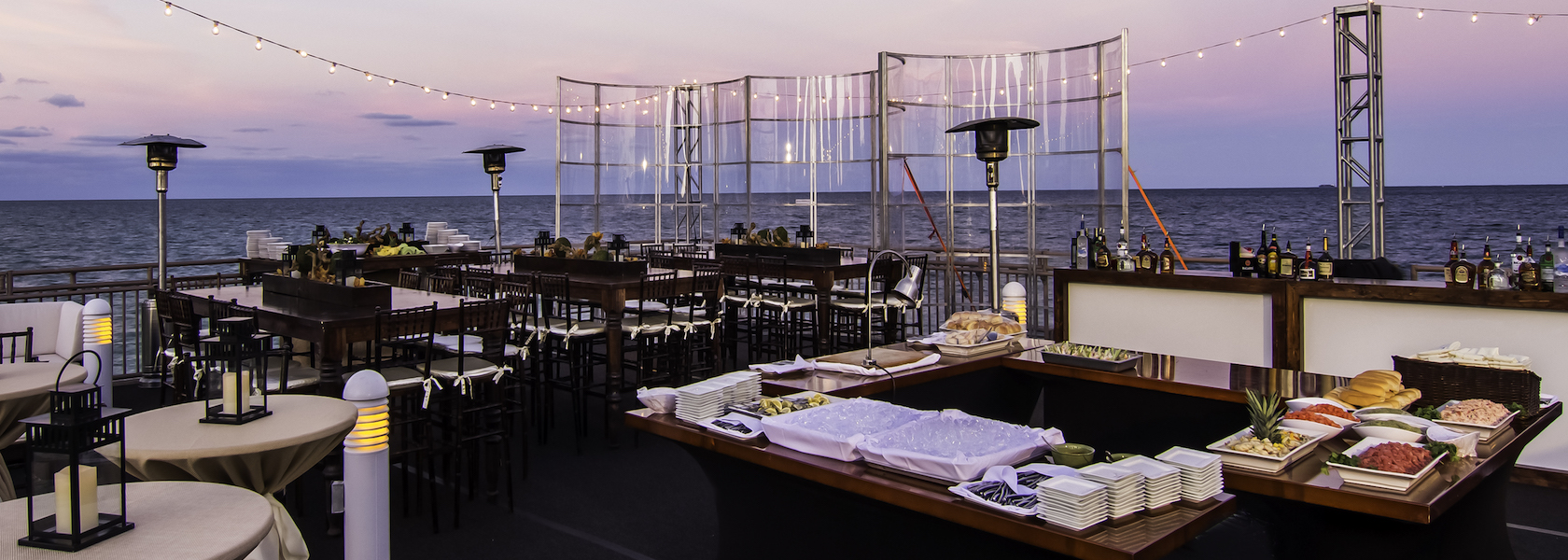 Party setting outdoors by the Ocean at the Newport Beachside Hotel and Resort