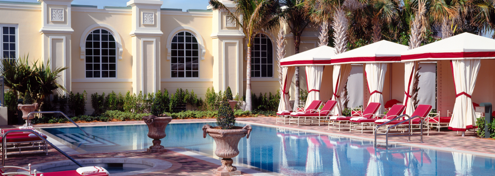 View of Acqualina pool, cabanas and greek style building.