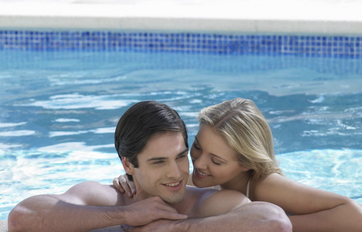 Couple in pool at Acqualina Resort & Spa