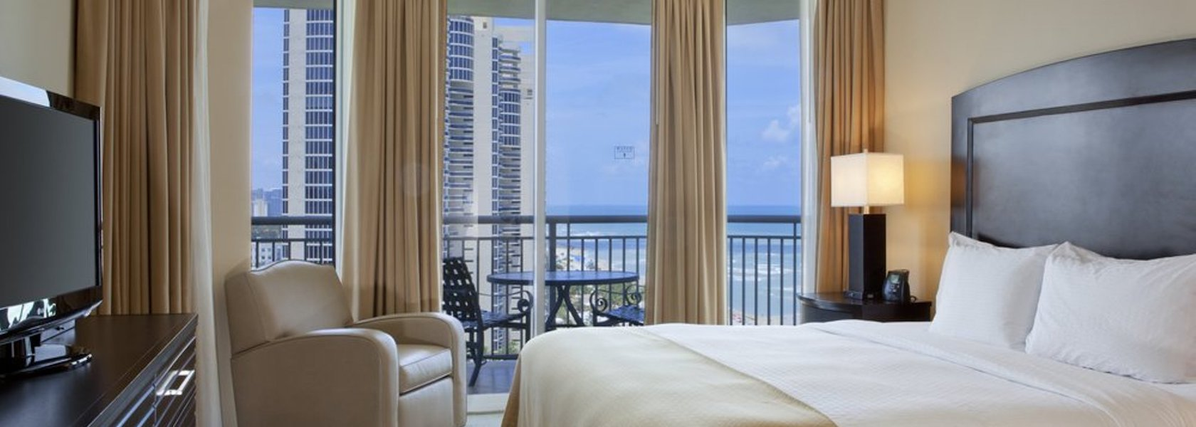 King bed in room overlooking the Atlantic Ocean