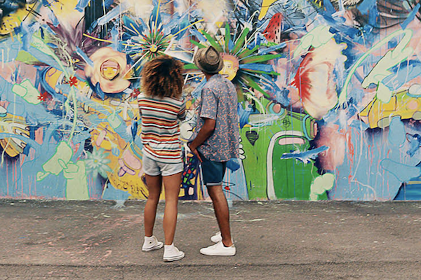 Couple looking at street art at Wynwood