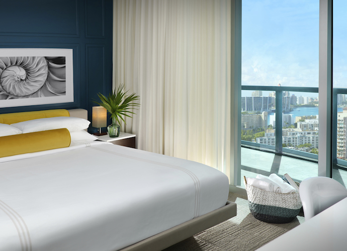 Guestroom and balcony overlooking City at Solé Miami