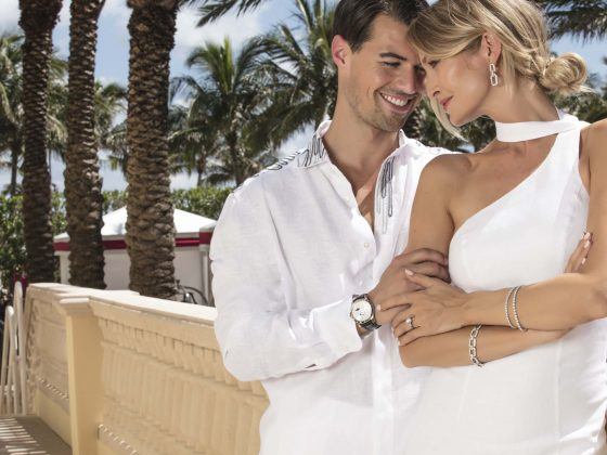Couple dressed in white at Acqualina.