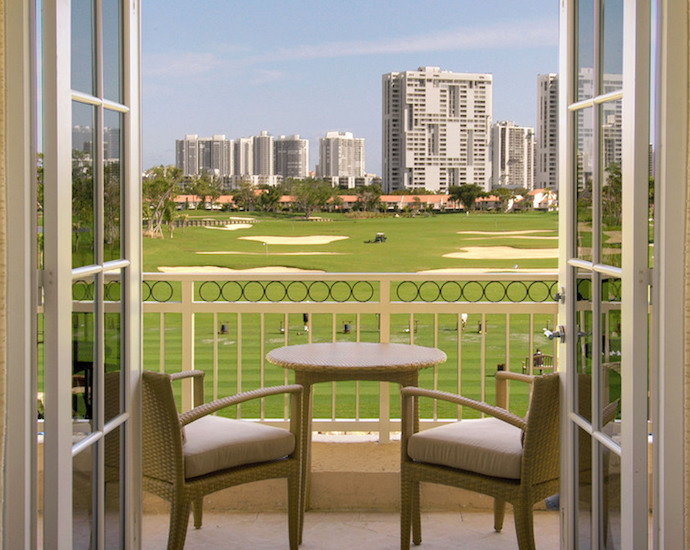 Balcony overlooking golf course at JW Marriott Miami Turnberry Resort & Spa