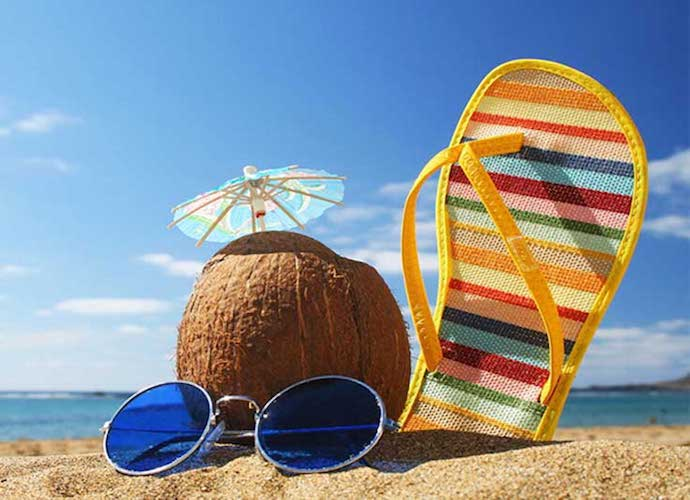 Coconut and sandal on beach