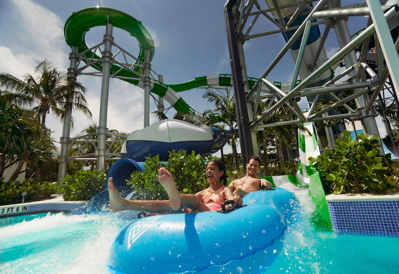 Father and kid on slide at Tidal Cove Waterpark