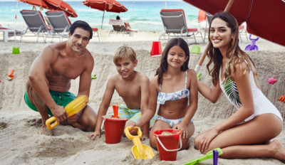 Family of four on the beach at Acqualina Resort & Residences on the Beach