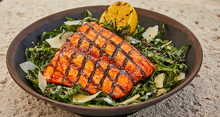 Salmon on plate of greens