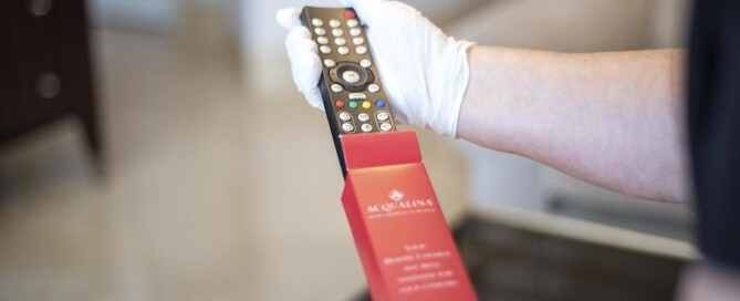 Remote being pulled out of sleeve at Acqualina