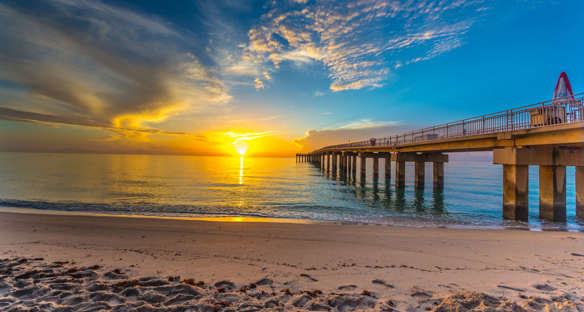 Sun rising over the ocean by the Newport Fishing Pier