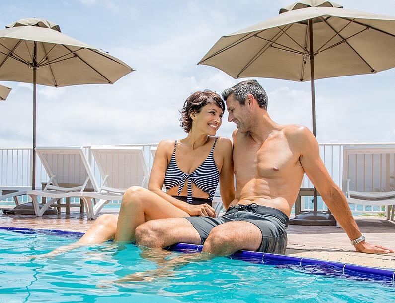 Couple enjoying the pool at Trump International Beach Resort
