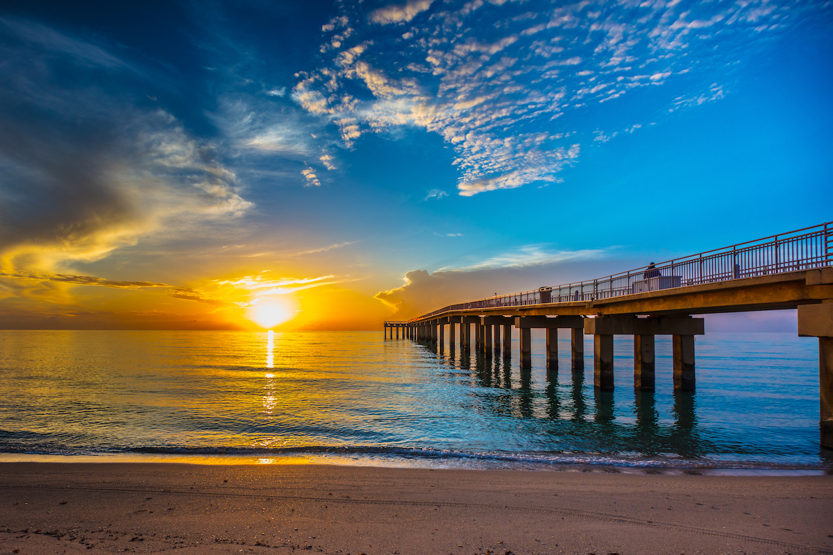 Sunrise over the ocean next to the Newport Fishing Pier