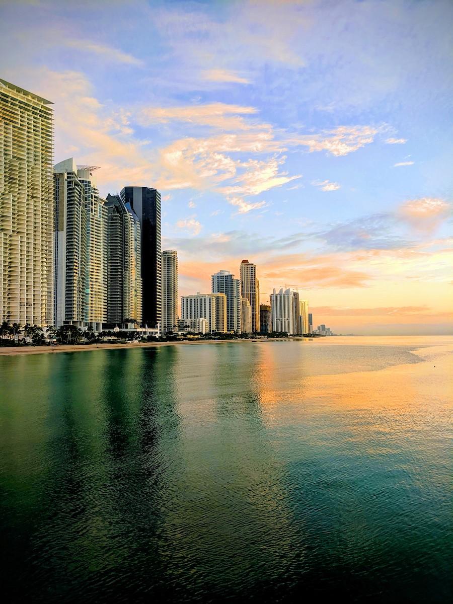 Sunrise over the ocean and City skyline.
