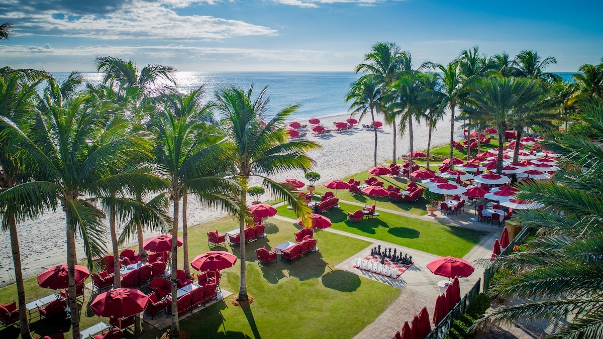Courtyard at Acqualina showing red umbrellas and longers.