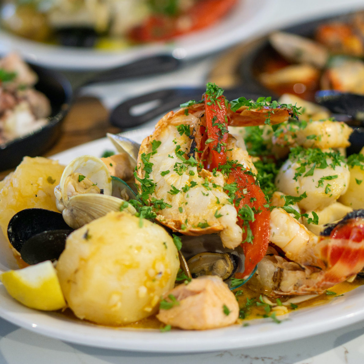 seafood dish from Old Lisbon restaurant with potatoes and black olives.